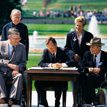 President Bush signs ADA act of 1990