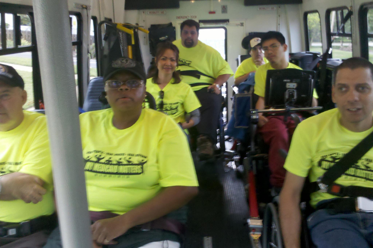 Group of adult students on a bus