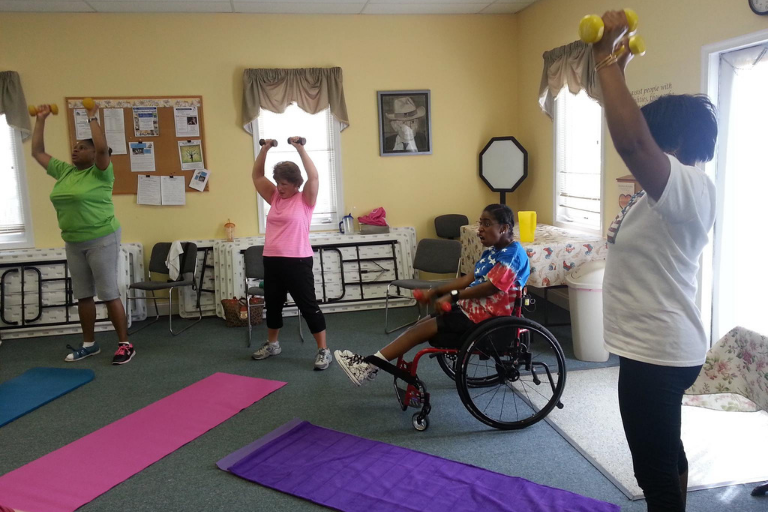 Group participates in adaptive yoga