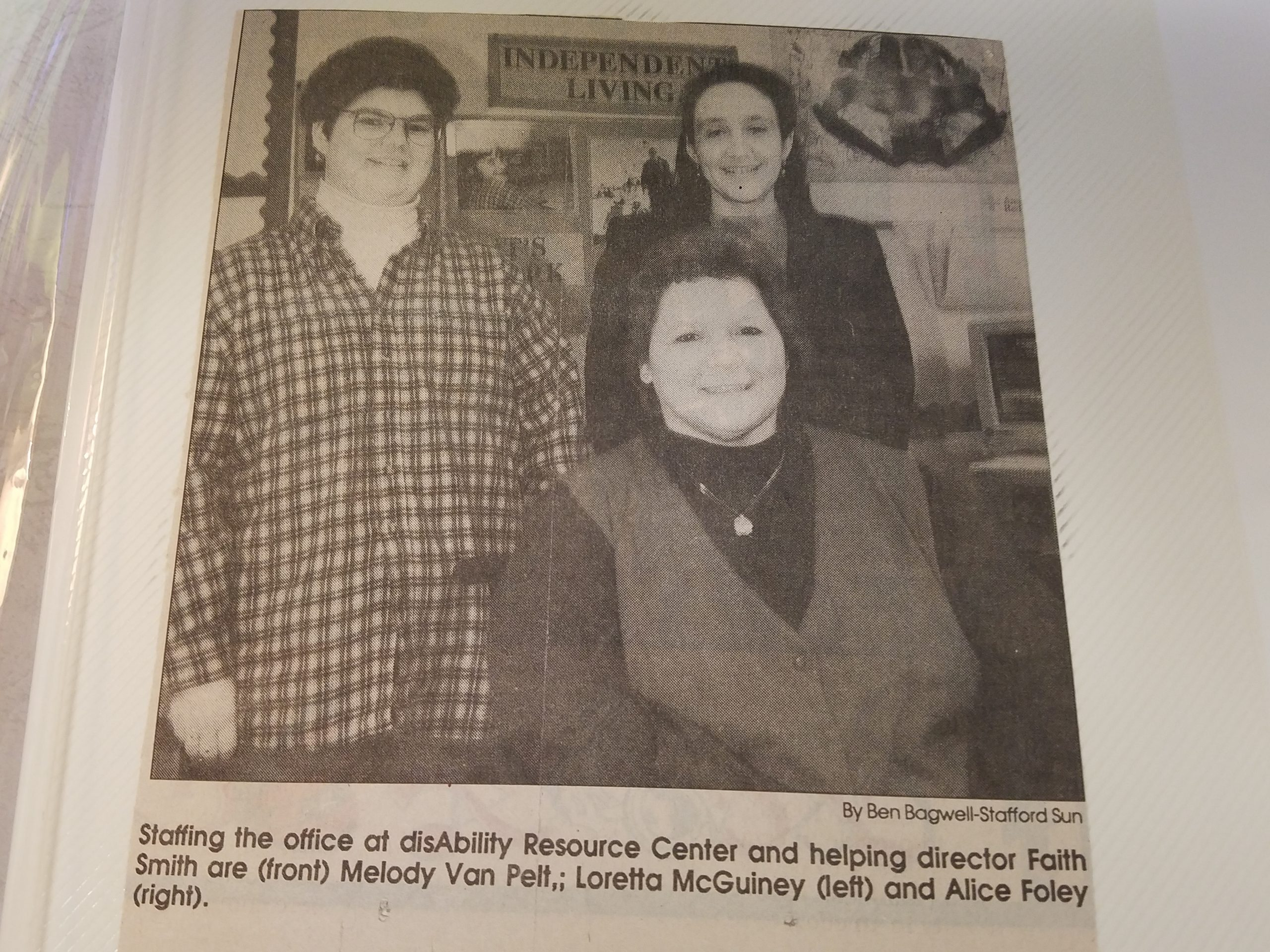 Newspaper picture with 3 people